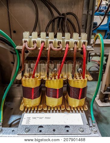 Electric transformer main in control panel box, in factory industry