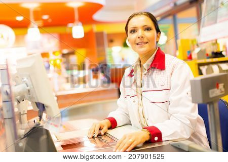 sales clerk at a cash register in the supermarket