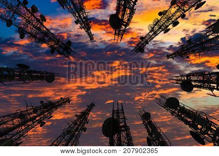Silhouette Of The Antenna Of Cellular Cell Phone And Communication System Tower With Beautiful Sunse