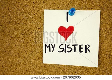 I love my sister Card with heart. I love my sister Card with heart on cork board background businnes concept