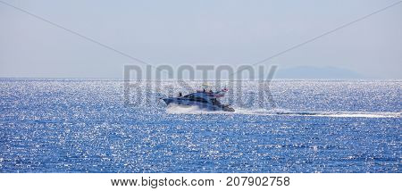 People with high-speed boat in the sea