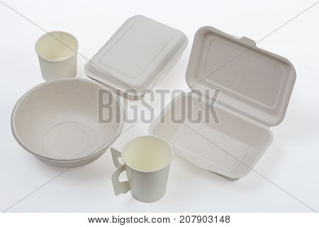 Set of unbleached plant fiber food box and paper coffee cup isolated on white with clipping path Natural fiber eco food and drink packaging.