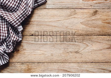 Wooden table background with kitchen textile or kitchen napkin. Cooking food, pizza table, picnic or food background with copy space for text. Top view