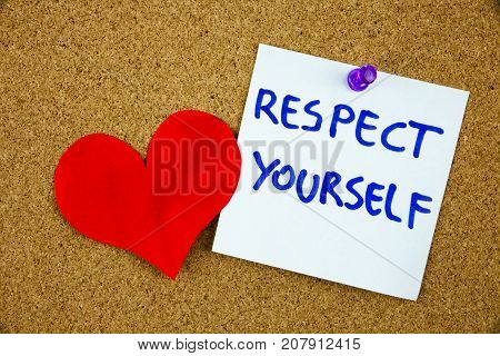The phrase Respect Yourself in red text on a lined index card pinned to a cork notice board as reminder