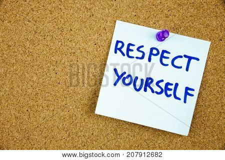The phrase Respect Yourself in red text on a lined index card pinned to a cork notice board as reminder. Businnes concept