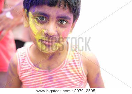 Holi celebrations - Closeup of a boy playing Holi in India