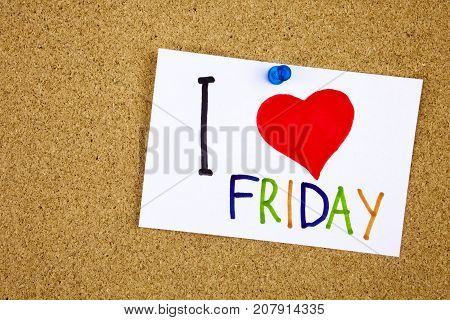 I love friday words made of colorful letters on the sticky note pinned to a cork notice board as reminder Businnes concept