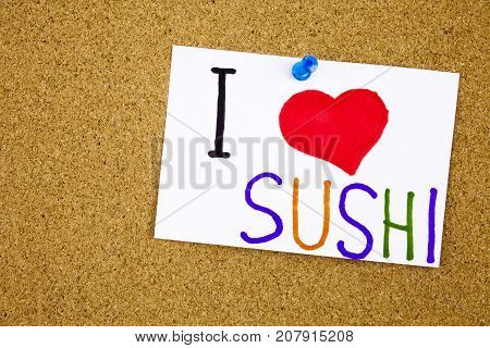 Sushi roll sticky note pinned to a cork notice health cocnept