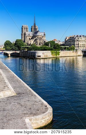 Notre Dame de Paris Cathedral on the Cite Island in the summer morning. Notre-Dame Cathedral is a medieval catholic cathedral and finest example of french gothic architecture. Paris France.