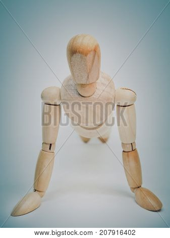 Wooden dummy model in exercise. Retro filter and selective focus