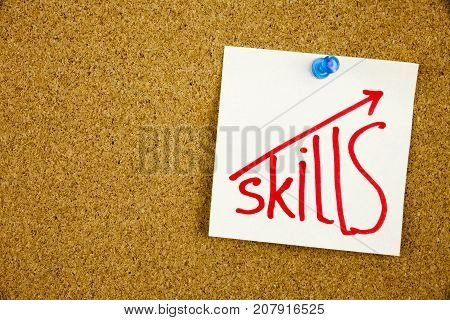 Skills written on sticky note pinned on pinboard Improve Your skills Businnes Concept
