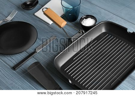 Kitchenware and tableware on wooden table