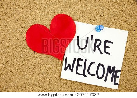 You Are wellcome sign written on sticky note pinned on pinboard Businnes concept