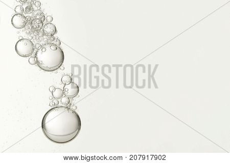 Flowing bubbles isolated over a blurred background.
