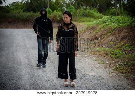 Robber Man With Gun Follow Victim Woman