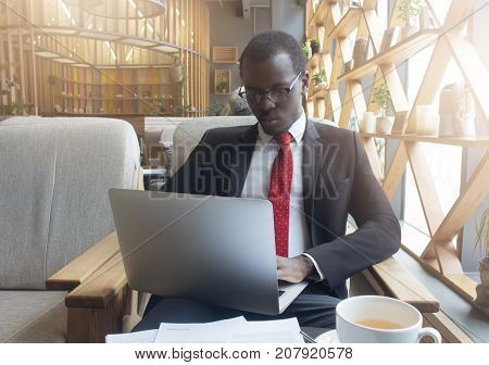 Indoor Closeup Of African American Businessman In City Cafe Dressed Formally As If On Business Trip