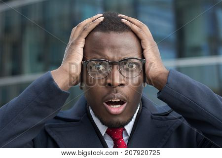 Oh My God! Closeup Of Young African American Business Man Standing In Street In City Center Looking