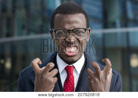 Horizontal Photo Of Young African American Businessman Pictured In City Center Looking Extremely Ten