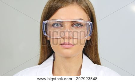 Close Up Of Female Reseach Scientist, Doctor Wearing Protective Glasses