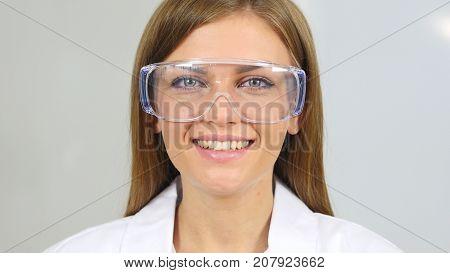 Smiling Female Chemist, Scientific Reseacher Looking At Camera