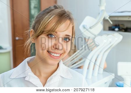 Young Professional Woman Dentist in the Dental Office