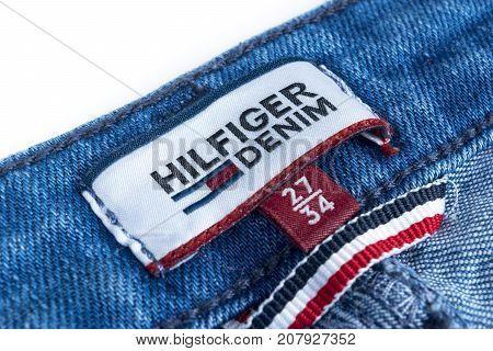 Sankt-petersburg Russia October 9 2017: Closeup of Tommy Hilfiger label on blue jeans. Tommy Hilfiger is lifestyle brand. Hilfiger Denim. Tommy Hilfiger blue jeans detail