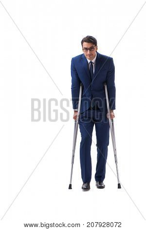 Businessman walking with crutches isolated on white background