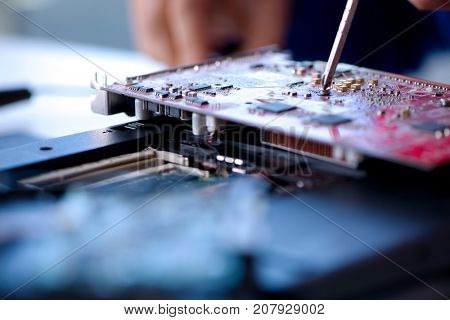 Repairman working in technical support fixing computer laptop tr