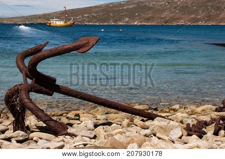 An old, rusty anchor lays ashore on Westpoint Island.