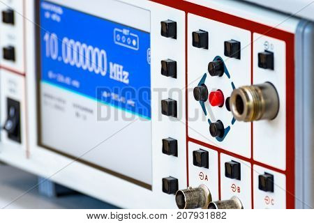 Fragment of a modern digital oscilloscope. Scientific measuring equipment. Abstract industrial background.