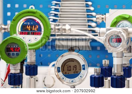 Electronic manometers. Modern instruments for measuring pressure. Abstract industrial background.