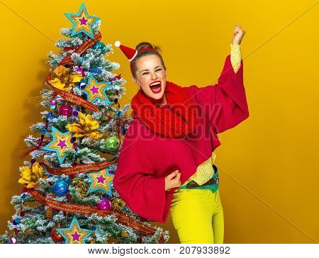 Smiling Trendy Near Christmas Tree Woman Rejoicing