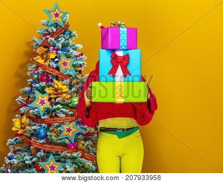 Woman Holding Pile Of Christmas Present Boxes