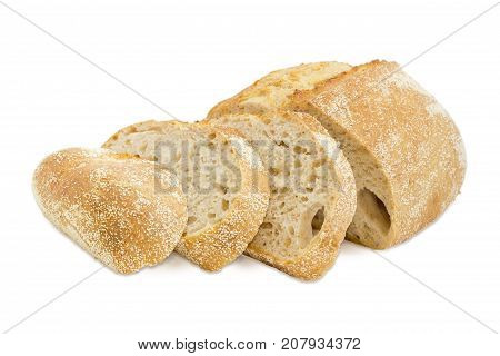 Partially sliced loaf of the wheat sourdough hearth bread with bran on a white background