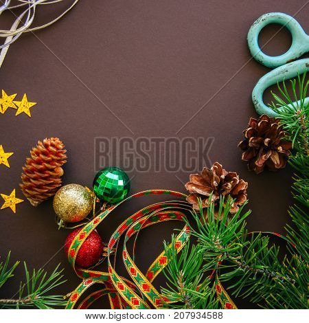 Festive Christmas Backdrop With Fir Tree Branches, Cones, Stars And  Decorative Ribbons Over Brown B