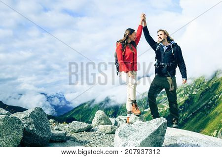 Young Couple Made it to the Top. Shot taken in Swiss Alps, near Rhone Glacier.