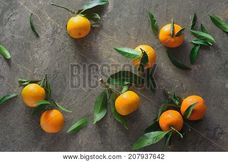 Tangerine moody background view from above, flat lay