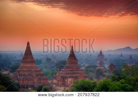 Beautiful sunrise over old pagodas of an ancient city of Bagan, Myanmar