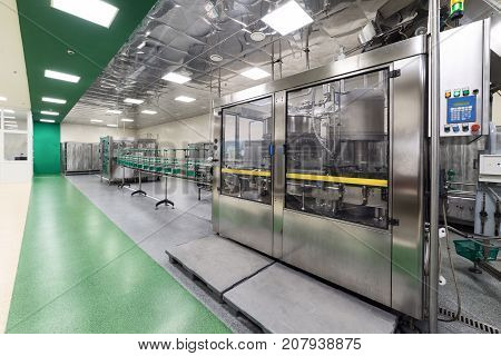The shop for bottling beverages. Automatic filling line. Factory for the production of alcoholic beverages.