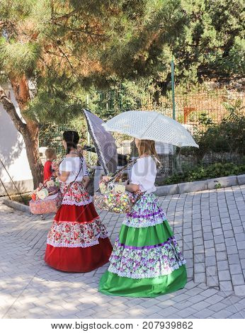 Yalta, Crimea - 11 July, Girls with umbrellas, 11 July, 2017. Small Castle Lastochkino Nest and its surroundings.