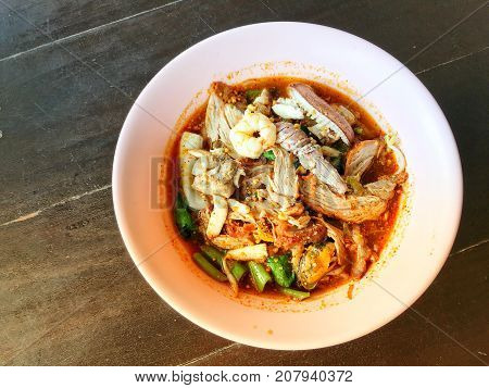 Noodles Seefood Tom Yum With Squid And Mantis Shrimp, Squid, Prawn In A Bowl On Wooden Table, Still