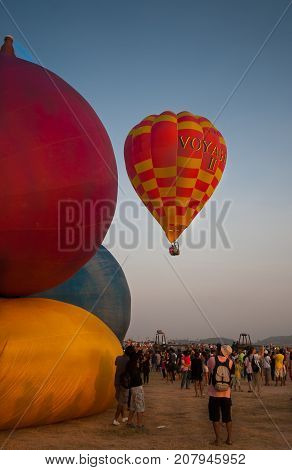 Chonburi, Thailand - December 12, 2009: Balloon flying in hot air Thailand International Balloon Festival 2009