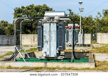 Old high voltage electric transformer power station. Industrial electricity facility on Silba - Croatia.