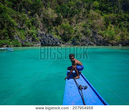 A Man Working On Boat In Coron, Philippines