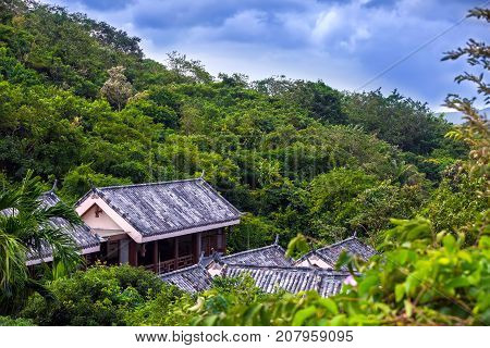Slate roof on a house in the jungle. Yalong Bay Tropic Paradise Forest Park, Hainan, China. The jungle is the most interesting thing that there is on the Sanya island for the traveler.
