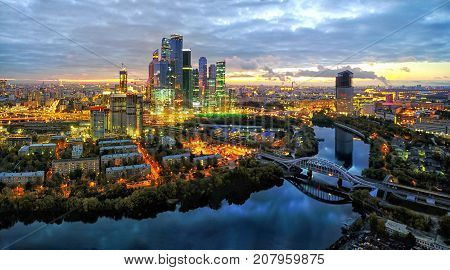 Moscow City district and Moscow river at dusk aerial view