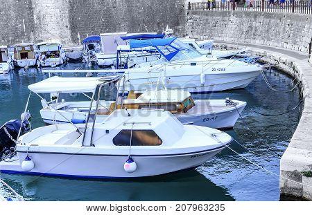 ZADAR, CROATIA - 14 JULY, 2017: Parking boats in the Gulf of Zadar, Croatia