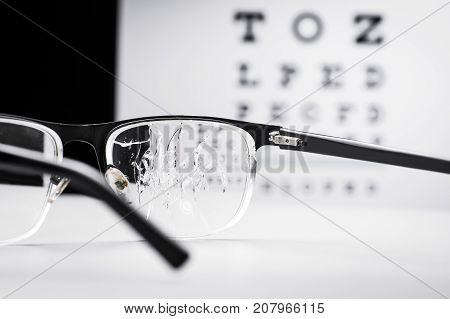 Cracked Glasses Against The Eye Chart