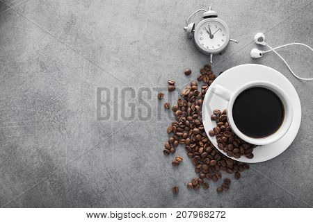 White Cup Of Coffee With Headphone And Coffee Beans