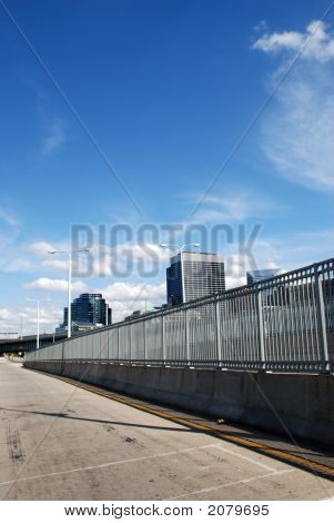 A long metal fence guarding the roadway poster